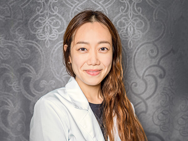 One of our leading Burlington dentists, Dr. Lim wearing her scrubs