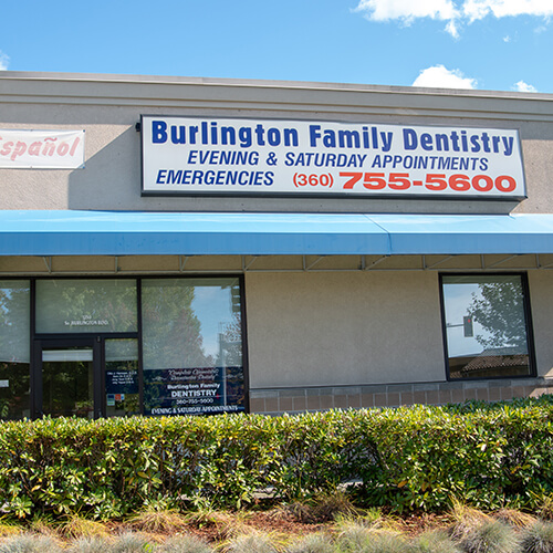 The Burlington dental office facade showing parking lot and building entrance